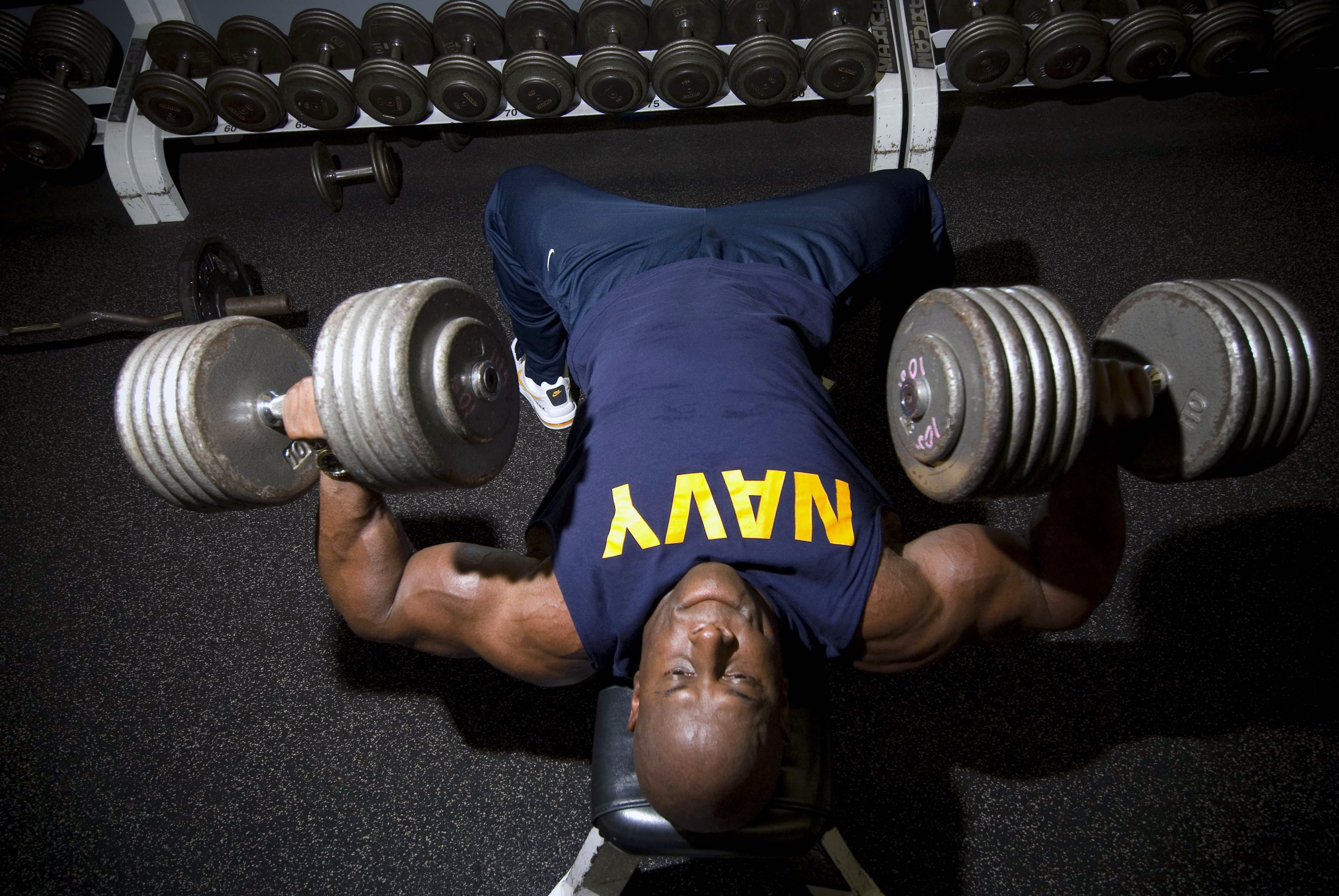 071017-N-0995C-008 PEARL HARBOR, Hawaii (Oct. 17, 2007) - Chief Mineman Kevin Sperling, an officer recruiter at Navy Recruiting Processing Station Honolulu, presses two 105-pound dumbbells to exercise his chest during a workout in Bloch Arena Gym at Naval Station Pearl Harbor. Sperling has been in the sport of bodybuilding for the past 10 years and was proclaimed ÒMr. HawaiiÓ in the 29th Hawaiian Islands Bodybuilding and Figure Championships held June 30. Most recently, he garnered a 10th place finish in the U.S.A. Body Building Championship, held in Las Vegas, July 27-28. U.S. Navy photo by Mass Communication Specialist 3rd Class Eric J. Cutright (RELEASED)